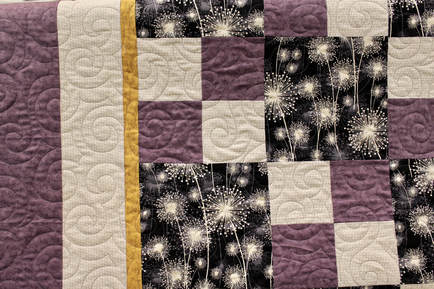 Picture of Jessie's Swirls Pantograph on Purple White and Black Quilt