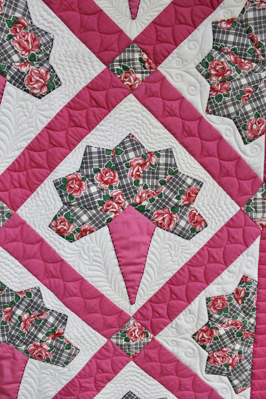 Photo of longarm quilting sample by Foxtail Quilting
