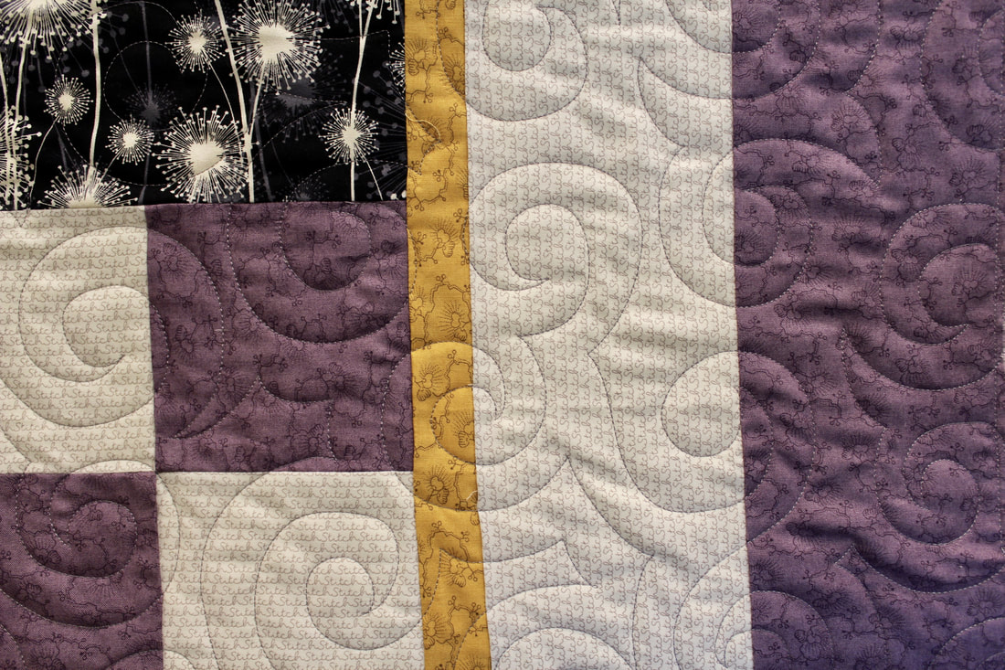 Picture of Jessie's Swirls Pantograph Design on Purple, White and Black Quilt