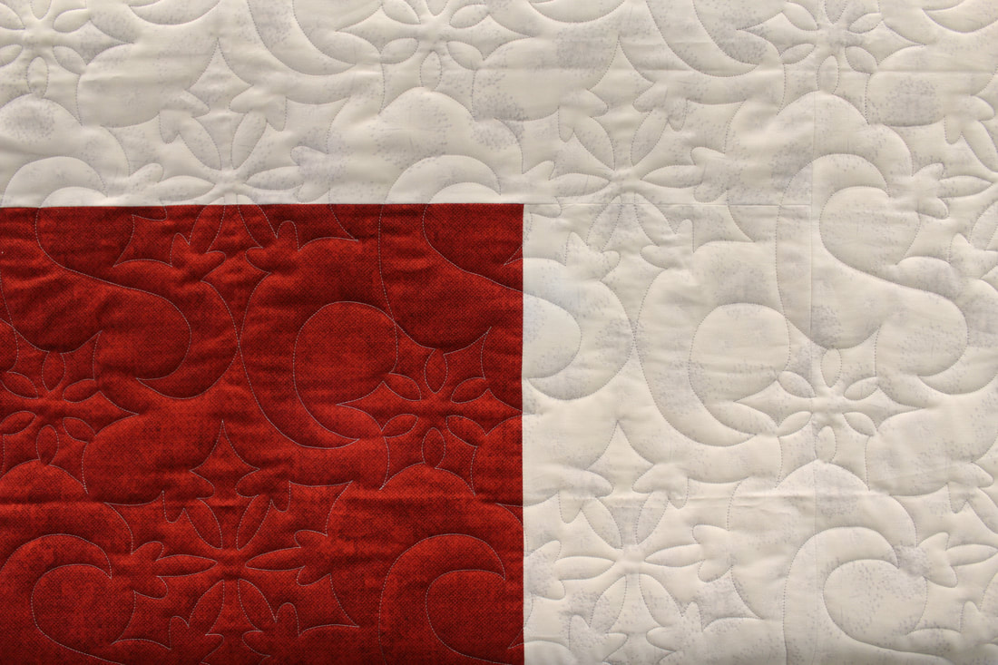 Picture Snow Winds Pantograph on Red and White Quilt