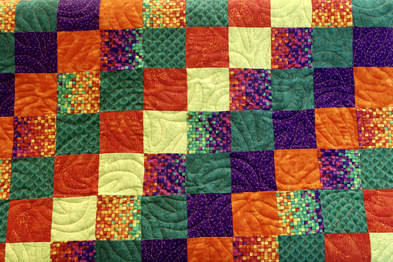 Photo of quilt top with Banana Swirls Pantograph